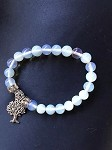 Bracelet, Hand-made, four strands, man-made Opalite ( a Stone of clear thinking and new beginning), 8mm
