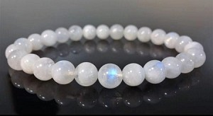 Bracelet, Hand-made, four strands, Moonstone ( a Stone that harvest the energy of the moon, which embodies yin's passive and relaxing energy), 8 mm